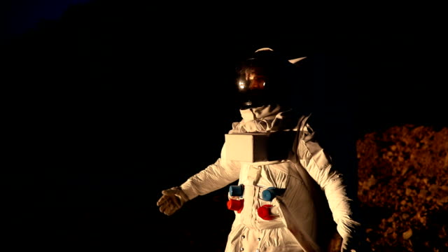 astronaut on dark mars - astronaut stock videos & royalty-free footage