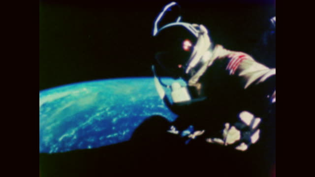 astronaut on spacewalk steadies camera to capture earth view - spacewalk stock videos & royalty-free footage