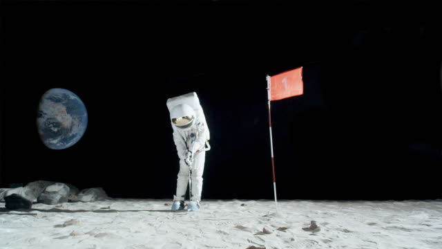ws slo mo astronaut playing golf on moon / berlin, germany - golf shot stock videos & royalty-free footage