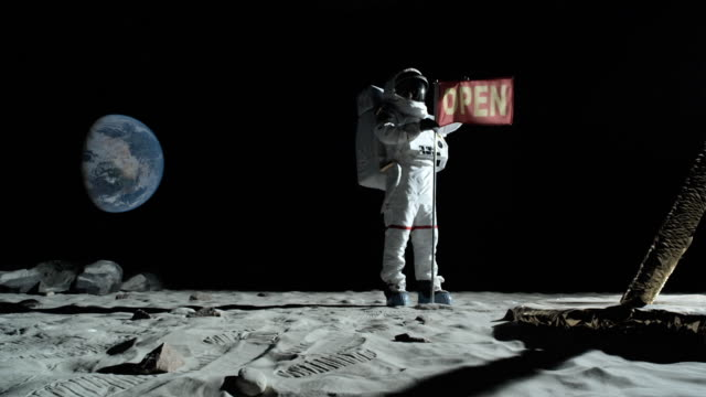 WS SLO MO Astronaut putting up an OPEN flag on the moon / Berlin, Germany