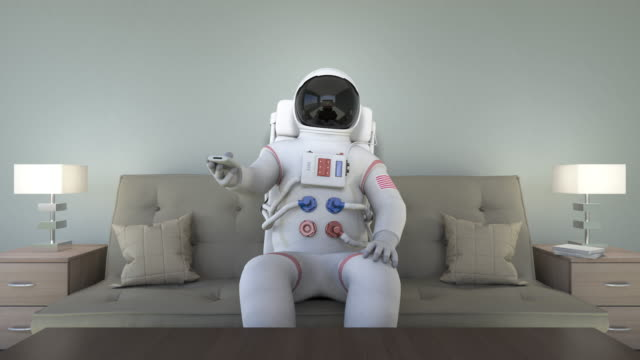 Astronaut Sitting On Couch Watching TV