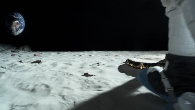 ms slo mo astronaut walking near lunar lander / berlin, germany - astronaut stock videos & royalty-free footage