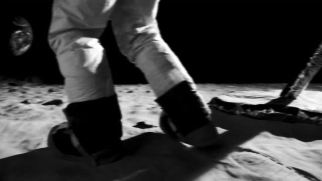 vídeos y material grabado en eventos de stock de ms slo mo b/w astronaut walking on moon surface near lunar lander / berlin, germany - blanco y negro
