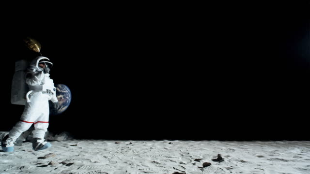 WS SLO MO Astronaut walking on the moon holding balloon / Berlin, Germany