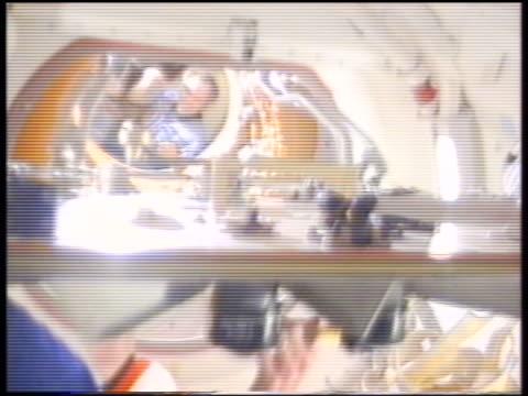 stockvideo's en b-roll-footage met astronaut wetherbee unlocking hatch of space shuttle greeting mir cosmonaut solvyev / sts86 - hatch