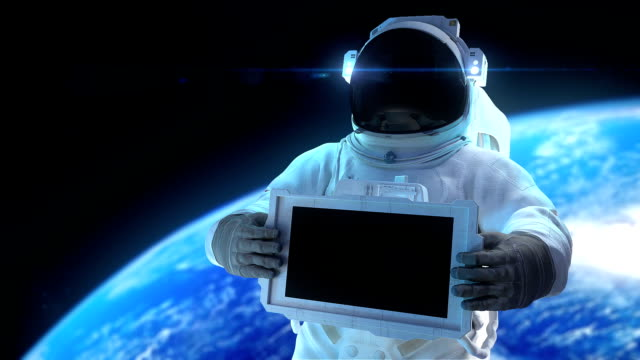 hd: astronaut with display - astronaut stock videos & royalty-free footage