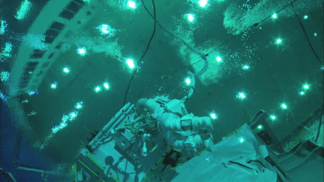 ws la astronaut working underwater in neutral buoyancy lab seen from below, houston, texas, usa - aerospace stock videos & royalty-free footage
