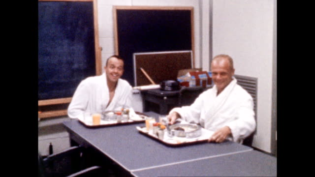 vídeos de stock e filmes b-roll de astronauts alan shepard and john glenn eating breakfast before project mercury iii mission on july 28 1961 in cape canaveral florida - 1961