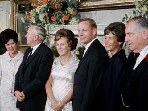 us astronauts buzz aldrin neil armstrong michael collins and their wives pose for photographs with harold wilson and his wife at number ten downing... - harold wilson stock-videos und b-roll-filmmaterial