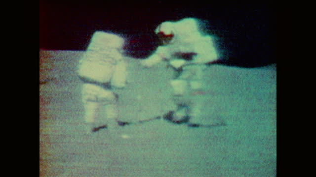 astronauts collect samples on moon's surface - 1969 stock videos & royalty-free footage