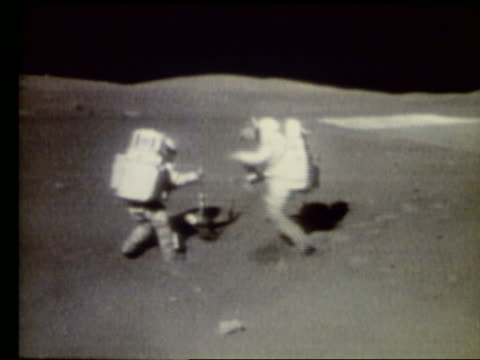 2 astronauts collecting moon rocks on Moon