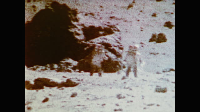 Astronauts Eugene A Cernan and Harrison Schmitt gather moon rocks during the Apollo 17 mission