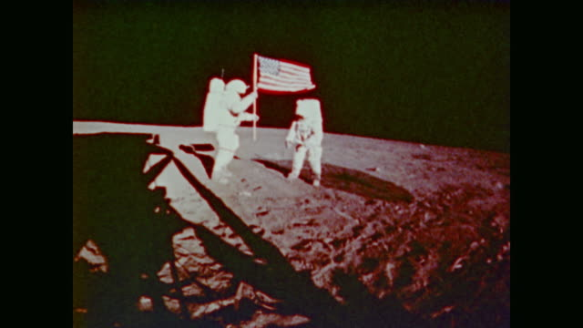 astronauts eugene a. cernan and harrison schmitt plant the apollo 17 flag at taurus-littrow lunar valley on the moon - 1972 stock videos & royalty-free footage