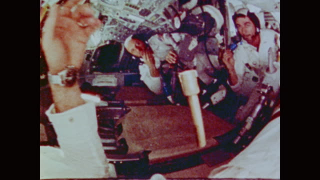 vídeos y material grabado en eventos de stock de astronauts of apollo 17, eugene cernan, ronald evans, harrison schmitt, deal with the pros and cons of zero gravity while trying to accomplish... - gravedad cero