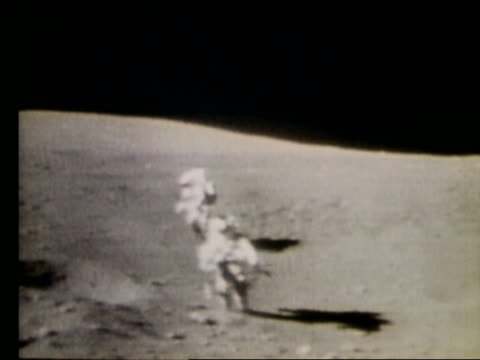 2 astronauts running toward camera on Moon / Apollo 16
