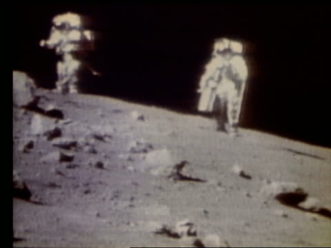 2 astronauts running toward camera on Moon