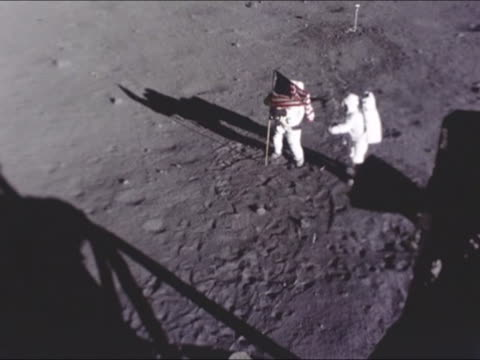 astronauts set an american flag on the lunar soil which they called 'tranquility base' apollo 11 was the first space flight landing humans in the... - moon stock videos & royalty-free footage