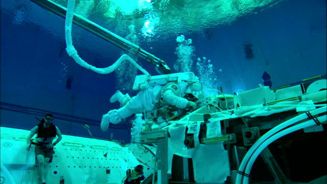 astronauts train in an underwater training center. - nasa video stock e b–roll