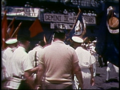 astronauts walking thru crowd after splashdown / gemini 4 - splashdown stock videos and b-roll footage