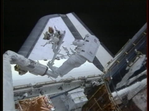 astronauts work outside a space shuttle cargo bay as nasa considers a new space shuttle mission to the hubble telescope. - astronomical telescope stock videos & royalty-free footage