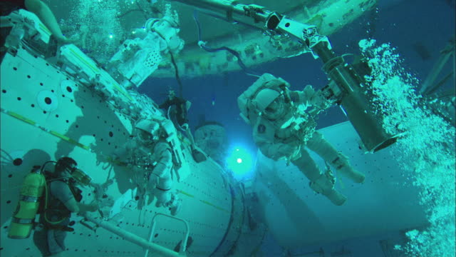 ws astronauts working underwater on mock up of international space station in neutral buoyancy lab, houston, texas, usa - astronaut stock videos & royalty-free footage