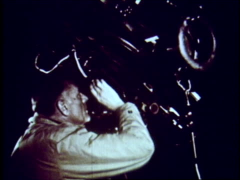Astronomer Edwin Hubble looking through telescope Astronomer Edwin Hubble on January 01 1959