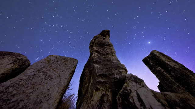 Astronomical time-lapse looking up rock pillars at Mount Arbel.