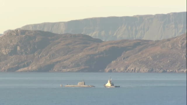 hms astute still stranded after running aground scotland isle of skye ext royal navy submarine hms astute in water off coast with another vessel... - ヘブリディーズ点の映像素材/bロール