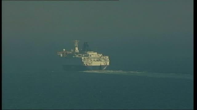 vídeos de stock e filmes b-roll de asylum seekers picked up while crossing english channel on children's lilos: shots of p&o ferry; itn england: kent: dover: ext gvs p&o stena ferry... - embarcação comercial