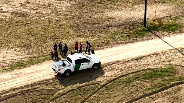 asylum seekers turn themselves in to a us border patrol agent after crossing from mexico into the united states on november 7 2018 in mission texas... - united states border patrol stock videos & royalty-free footage