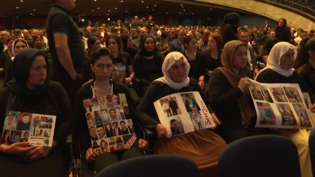 at a congress in stuttgart germany the yazidis commemorate the beginning of the genocide against their people committed by daesh five years ago in... - isil konflikt stock-videos und b-roll-filmmaterial