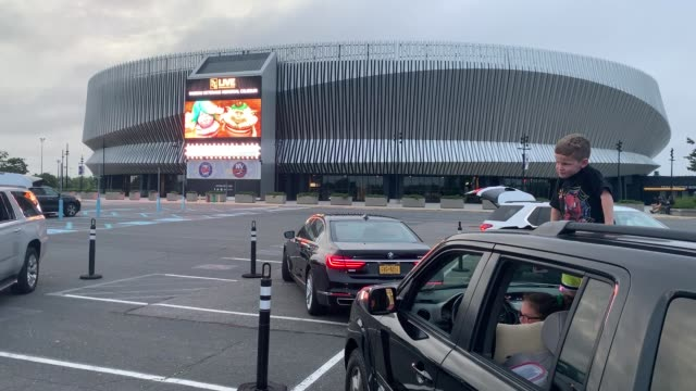 at a drivein movie arranged by nassau county residents watch the movie trolls in the parking lot of nycb's live at the nassau coliseum on may 29 2020... - nassau stock videos & royalty-free footage