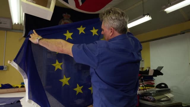 at a flag making workshop in northern england orders for union jacks are flying off the production line while the eu's blue and yellow standard is... - knaresborough stock videos & royalty-free footage