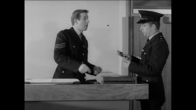 ts at a police station, an officer is giving information to another officer regarding a possible threat / chester, england, united kingdom - 英国チェスター点の映像素材/bロール