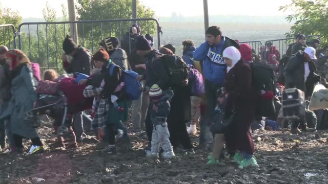 at a small checkpoint at the serbo croatian border hundreds of migrants tired and impatient of waiting in the cold and mud and many carrying small... - push in stock videos & royalty-free footage