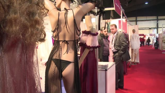at a stall in a beirut exhibition hall syrian businesswoman reem abu dahab displays her workshops lacy pink and white nightgowns hoping to attract... - nightdress stock videos & royalty-free footage