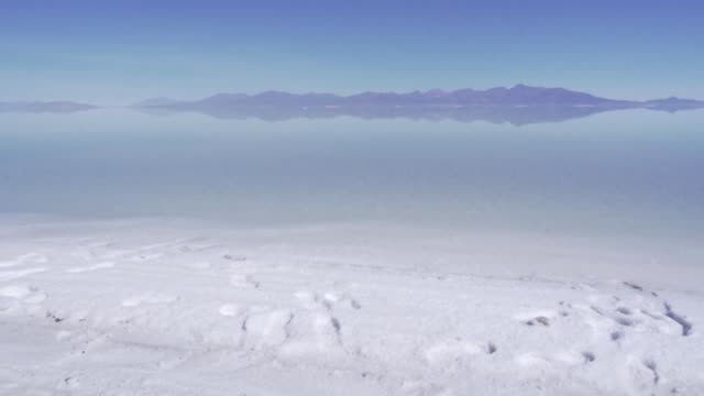 at almost 4,000 meters above sea level in the uyuni salt flat trucks constantly come and go to the extraction basins: in one of the largest deposits... - lithium stock videos & royalty-free footage