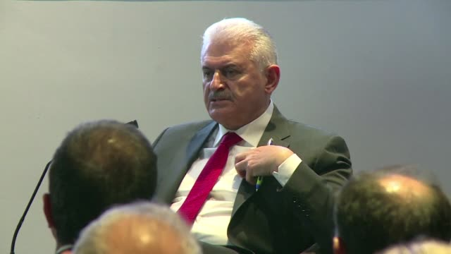 At an event in London Turkey's Prime Minister criticizes NATO for not doing more to help his country and says that US cooperation with Kurdish YPG...