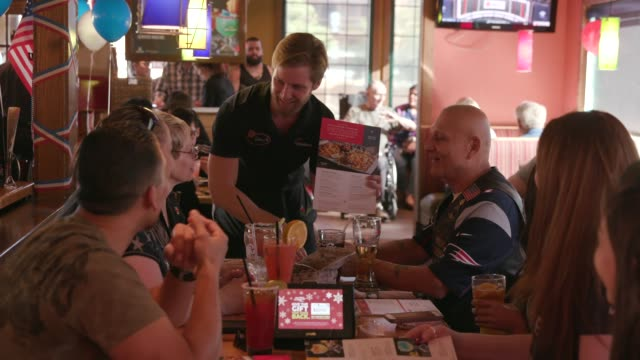 at applebee's neighborhood grill & bar & rob riggle, actor and retired united states marine corps reserve officer, serves free meals to military... - veterans day stock videos & royalty-free footage