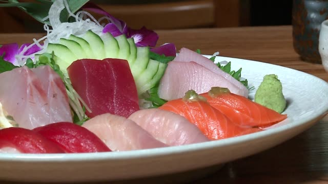 wgn at arami a chicago japanese restaurant on dec 14 2016 - nigiri stock videos and b-roll footage