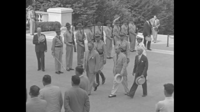 at arlington national cemetery dominican republic dictator rafael trujillo accompanied by officers walking away from the tomb of the unknown soldier... - civilian conservation corps stock-videos und b-roll-filmmaterial