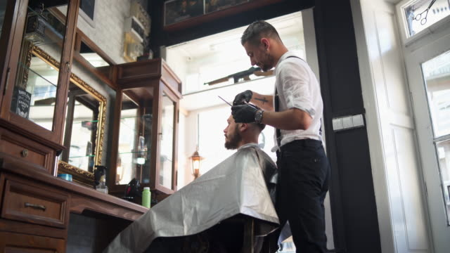 at barber shop - barber chair stock videos & royalty-free footage