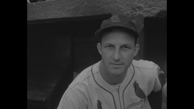 At Briggs Stadium St Louis Cardinals' Stan Musial and Pittsburgh Pirates' Ralph Kiner stand on edge of dugout for photo opportunity during the...