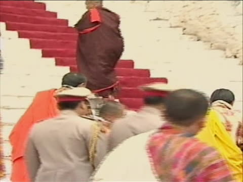 at dawn, at a time selected by astrologers, thirty one year old king jigme khesar married jetsun pema in a traditional buddhist ceremony. - religious dress stock videos & royalty-free footage