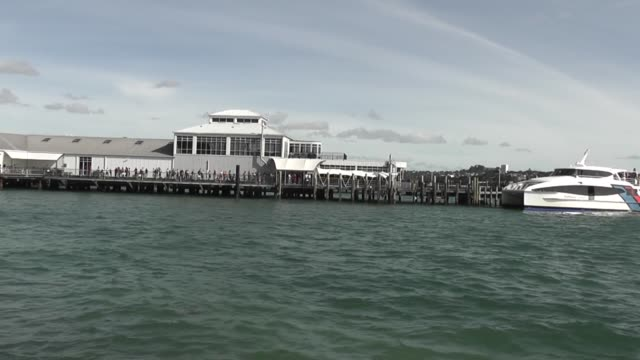 at devonport ferry building in auckland, nz. with passengers waiting to board. - auckland ferry stock videos & royalty-free footage