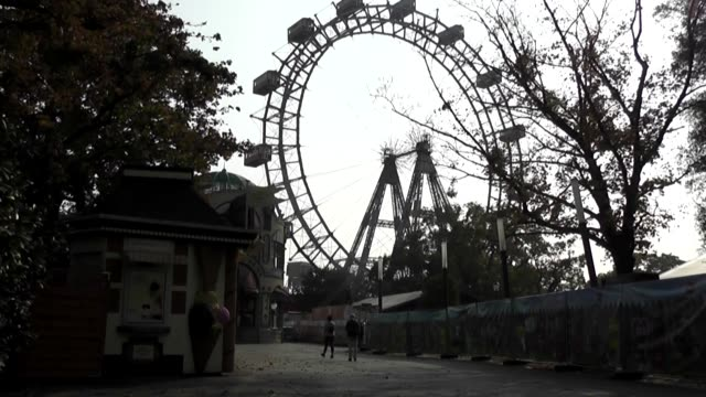 at dusk in first shot the wheel itself is moving slowly famous for featuring in the movie the third man - prater park stock videos & royalty-free footage