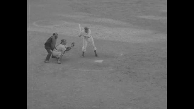 at ebbets field brooklyn dodgers' cookie lavagetto swings two bats as he prepares to bat in game 5 of the world series against the new york yankees /... - ebbets field video stock e b–roll