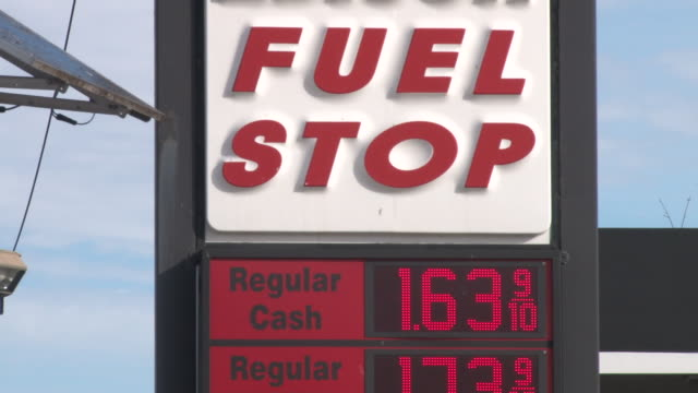 at edison fuel stop the cash price of unleaded gasoline has dropped to $163 per gallon / montage includes cu on sign showing price and cars pulling... - unleaded stock videos and b-roll footage