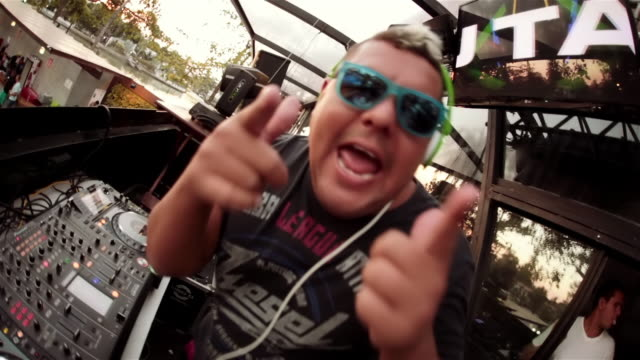 dj at exclusive club rocks out for camera and makes heart with hands - club dj stock videos & royalty-free footage