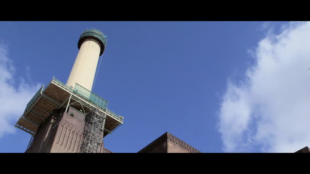 clean at first view of the newly rebuilt chimney at battersea power station at battersea power station at battersea power station on june 18 2015 in... - rebuilding stock videos and b-roll footage